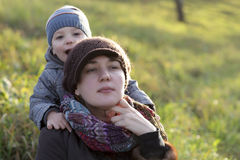 Mother with son on the grass Royalty Free Stock Images