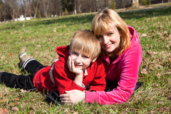Mother with the son on a grass in park Stock Photo