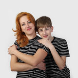 Mother and son on gray Stock Images