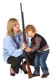 Mother and son with gun Royalty Free Stock Photography