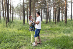 Mother and son had a  dancing in a summer forest Royalty Free Stock Photo