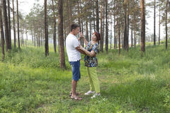 Mother and son had a  dancing in a summer forest Stock Image
