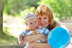 Mother and son in the hands Royalty Free Stock Photo