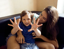 Mother with son, happy family at home Stock Photos