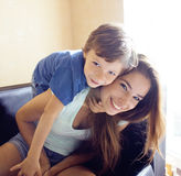 Mother with son, happy family at home, smiling Stock Photo
