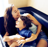Mother with son, happy family at home, smiling lifestyle people concept. Close up stock images