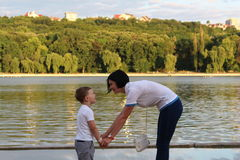 Mother with son. Happy mother and son have fun at lake shore looking at each other Royalty Free Stock Images