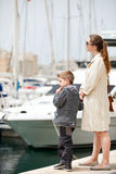 Mother and son at harbor Stock Image