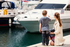 Mother and son at harbor stock images