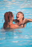 Mother and son have fun swimming Stock Images