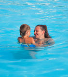 Mother and son have fun swimming Royalty Free Stock Photo