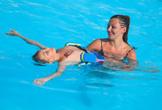 Mother and son have fun swimming royalty free stock image
