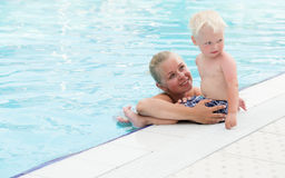 Mother and son have fun by a swimming pool Royalty Free Stock Photo