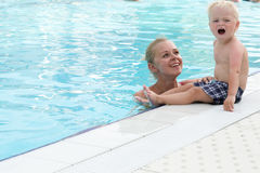 Mother and son have fun by a swimming pool Royalty Free Stock Image