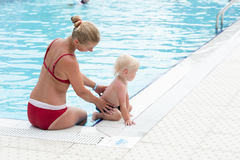 Mother and son have fun by a swimming pool Stock Photos
