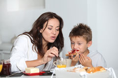 Mother and son having breakfast Royalty Free Stock Image