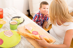 Mother and Son having breakfast at home Royalty Free Stock Images