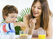 Mother and son having breakfast. Royalty Free Stock Images