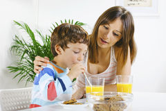 Mother and son having breakfast. Stock Image