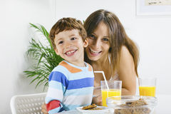 Mother and son having breakfast. Stock Photos