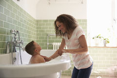 Mother And Son Having Fun At Bath Time Together Royalty Free Stock Image