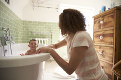 Mother And Son Having Fun At Bath Time Together Stock Image