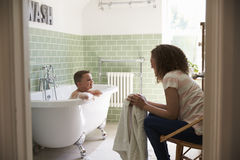 Mother And Son Having Fun At Bath Time Together Stock Photos