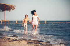 Mother and son having fun on the beach Stock Photography