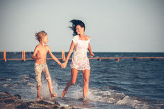 Mother and son having fun on the beach Royalty Free Stock Photos