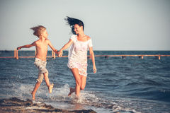 Mother and son having fun on the beach Stock Images