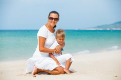 Mother and son having fun on the beach. Mother and son having fun on tropical beach Royalty Free Stock Photos