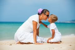 Mother and son having fun on the beach. Mother and son having fun on tropical beach Royalty Free Stock Photography