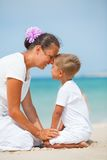 Mother and son having fun on the beach. Mother and son having fun on tropical beach Royalty Free Stock Images
