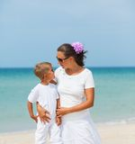 Mother and son having fun on the beach. Mother and son having fun on tropical beach Royalty Free Stock Image