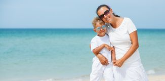 Mother and son having fun on the beach Royalty Free Stock Photography