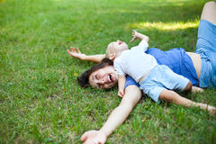 Mother and son having fun on the grass in park Royalty Free Stock Photo