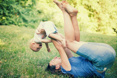 Mother and son having fun on the grass Royalty Free Stock Photo