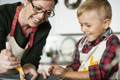 Mother and son having fun in the kitchen royalty free stock photo