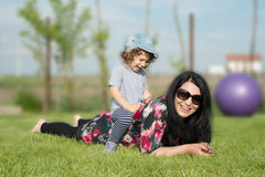 Mother and son having fun outside Stock Images