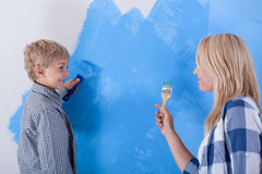 Mother and son having fun from painting the wall Stock Photo