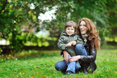 Mother and son having fun in a park Royalty Free Stock Photography