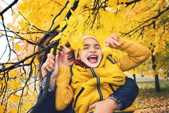 Mother and son having fun in park outdoors. Mum and son together stock images