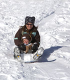 Mother and son having fun on the sled hill Royalty Free Stock Photography