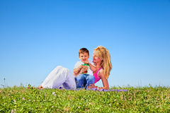 Mother and son having fun  in summer day Royalty Free Stock Photo