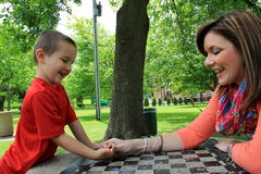 Mother and son having fun thumb wrestling Stock Image