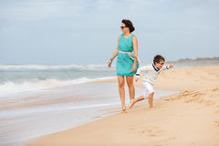 Mother and son having fun on a tropical beach Royalty Free Stock Photography