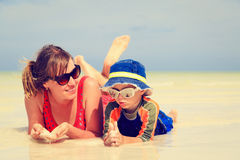 Mother and son having fun with water at beach Royalty Free Stock Image