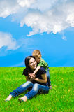Mother and son having fun. Young mother and son having fun in the meadow Royalty Free Stock Image