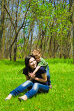 Mother and son having fun. Young mother and son having fun in the woods Stock Photography