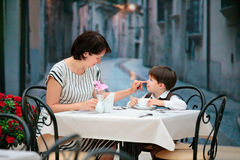 Mother and son having lunch together. At the mall Stock Photography